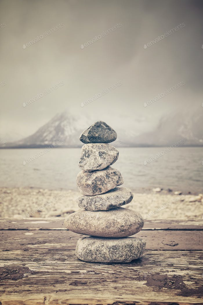 Vintage toned stack of stones, balance and harmony concept.