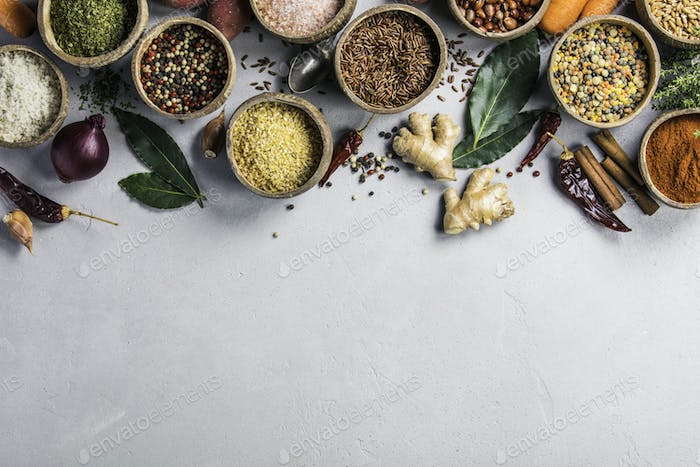 Healthy ingredients and spices on rustic murble background