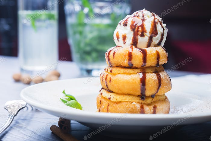 delicious dessert donuts with apples and ice cream on a white plate