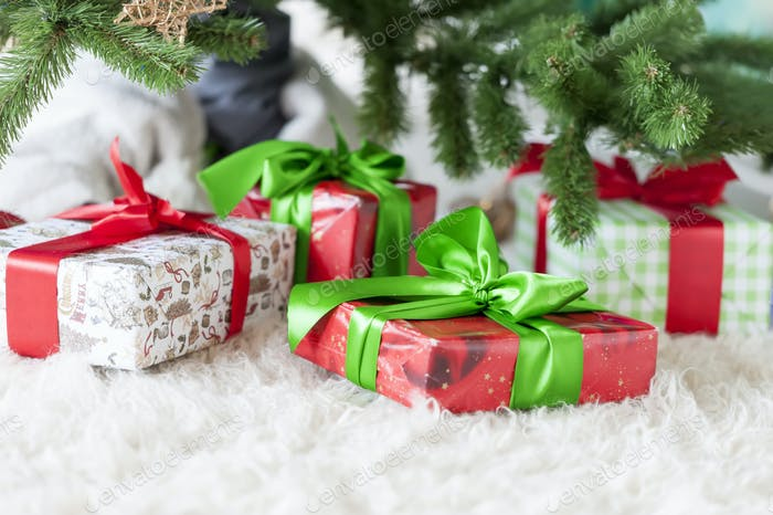 Christmas home decoration with gifts and tree