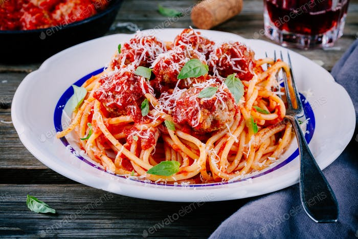 Spaghetti pasta with meatballs, tomato sauce and parmesan cheese