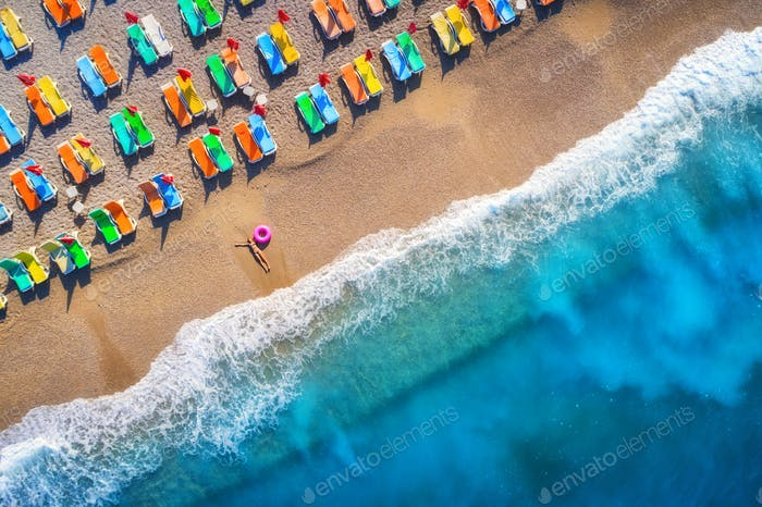 Aerial view of lying woman with swim ring in the sea in Oludeniz