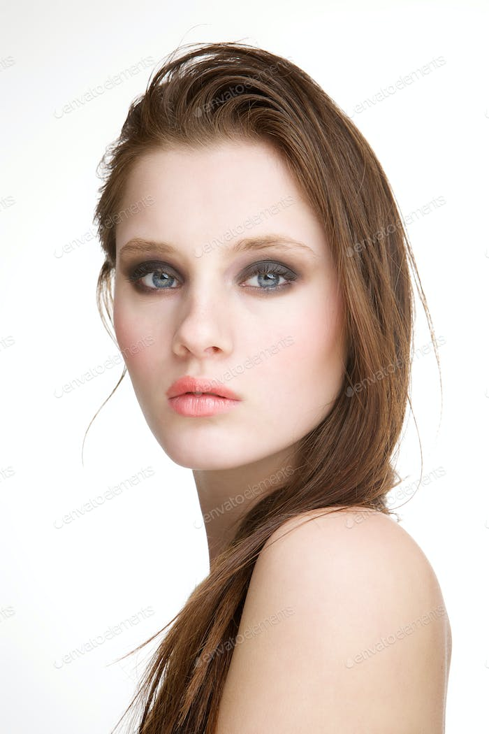 Fashion model posing on white background