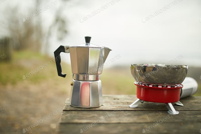 Process of making camping coffee outdoor with metal geyser