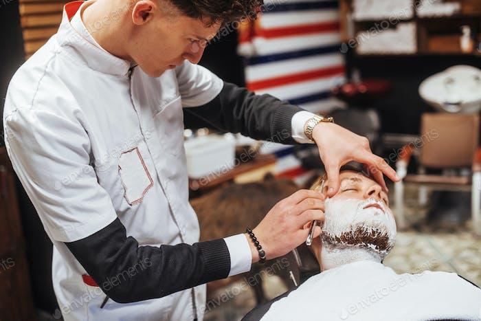man in the barbershop beard clipper