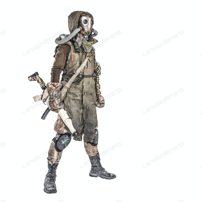Post apocalyptic creature in gas mask armed by gun