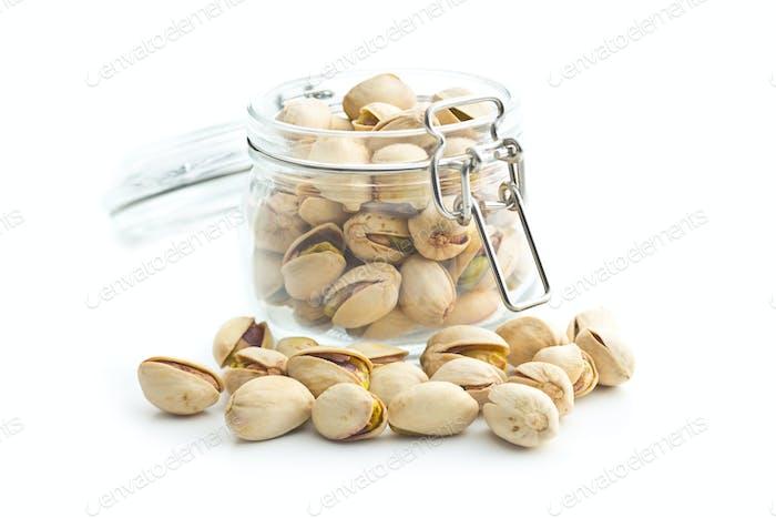 Pistachio nuts in jar.