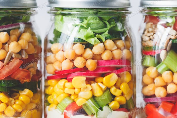 Three glass jars with salad