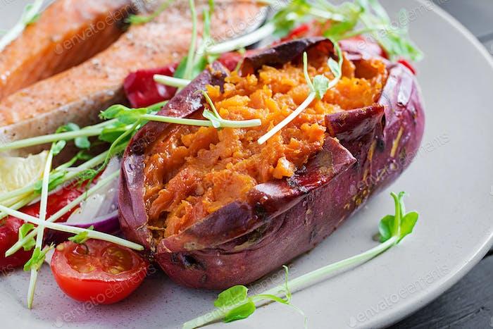 Baked sweet potatoes with butter. Vegetarian cuisine. Diet menu.