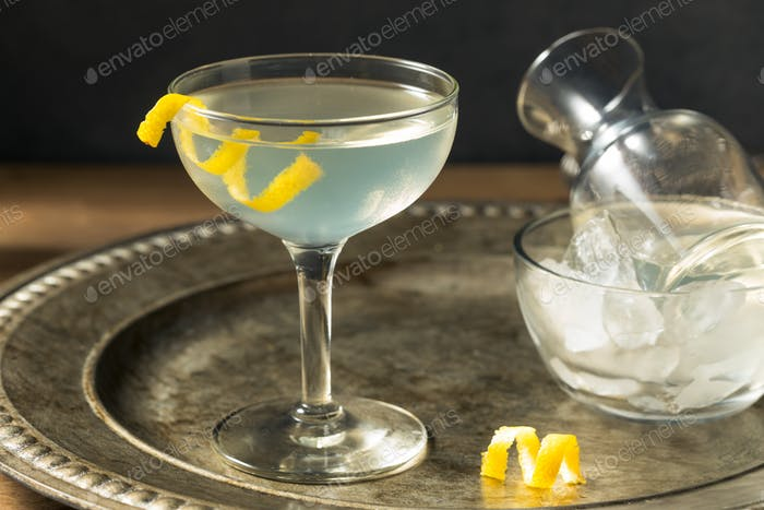 Refreshing Dry Martini with a Lemon Garnish