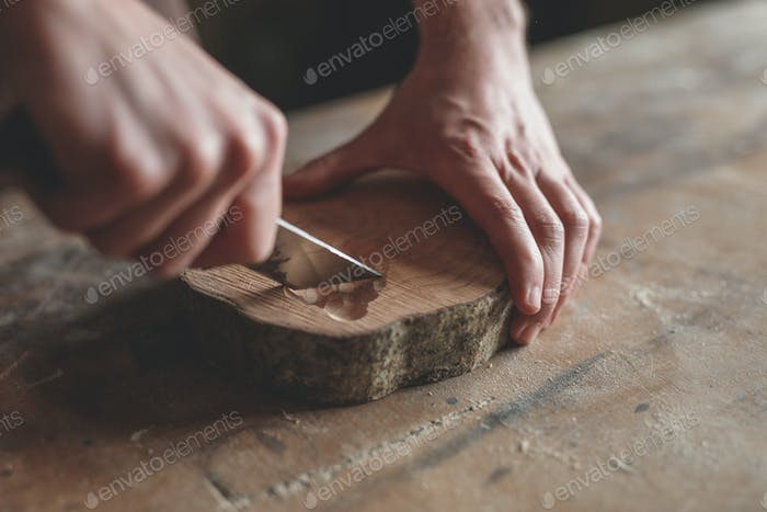 Men's hands with wood in carpentry