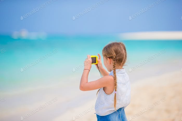 Little girl making video or photo with her camera