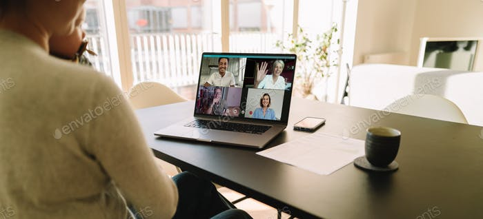 Business team meeting online over a video conference