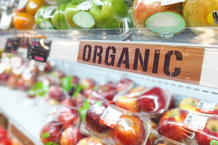 Organic food signage on modern supermarket fresh produce fruits