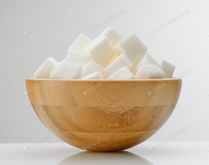 wooden bowl with white sugar cubes