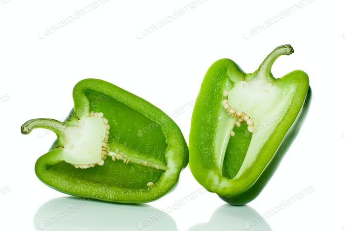 Two halves of green sweet pepper