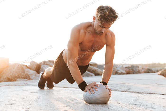 Portrait of a healthy shirtless sportsman