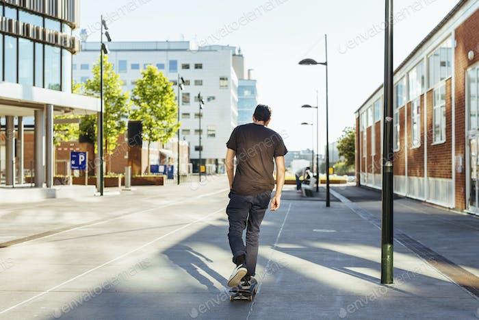 Rear view of man on skateboard