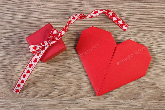 Wrapped gift with ribbon and heart as decoration for Valentines Day