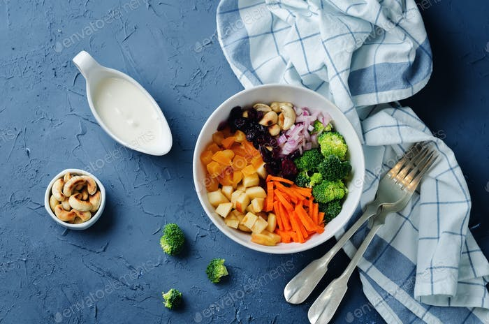 Broccoli carrot cashews apple salad with honey greek yogurt dres