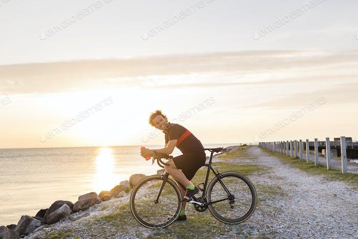 Cyclist by sea
