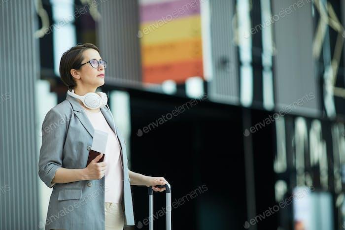 Modern woman reading flight schedule