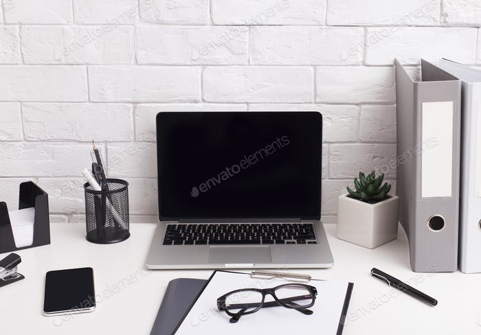 Laptop with blank screen for accountant application on table
