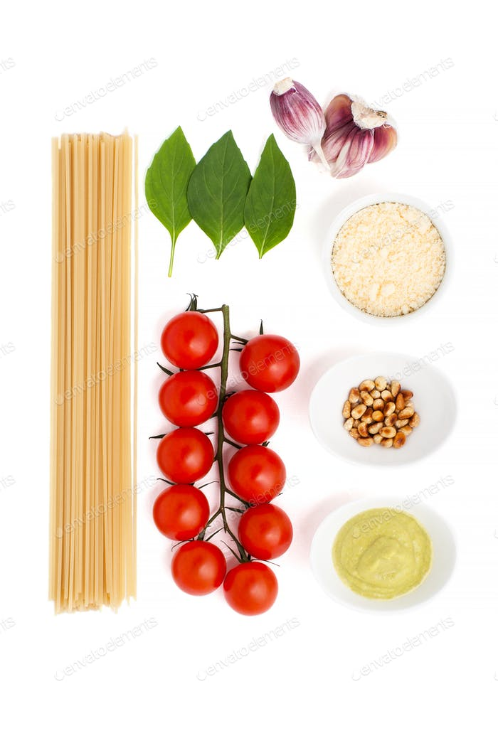 Set for cooking pasta with Pesto sauce and tomatoes on a white b