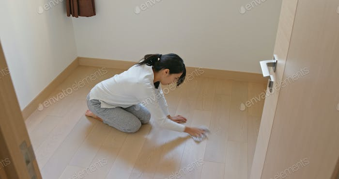 Asian Woman clean the floor for spring clean