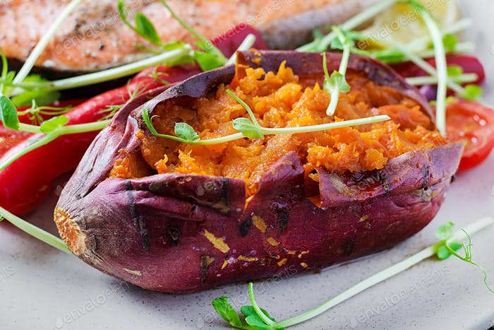 Baked sweet potatoes with butter. Vegetarian cuisine. Diet menu.