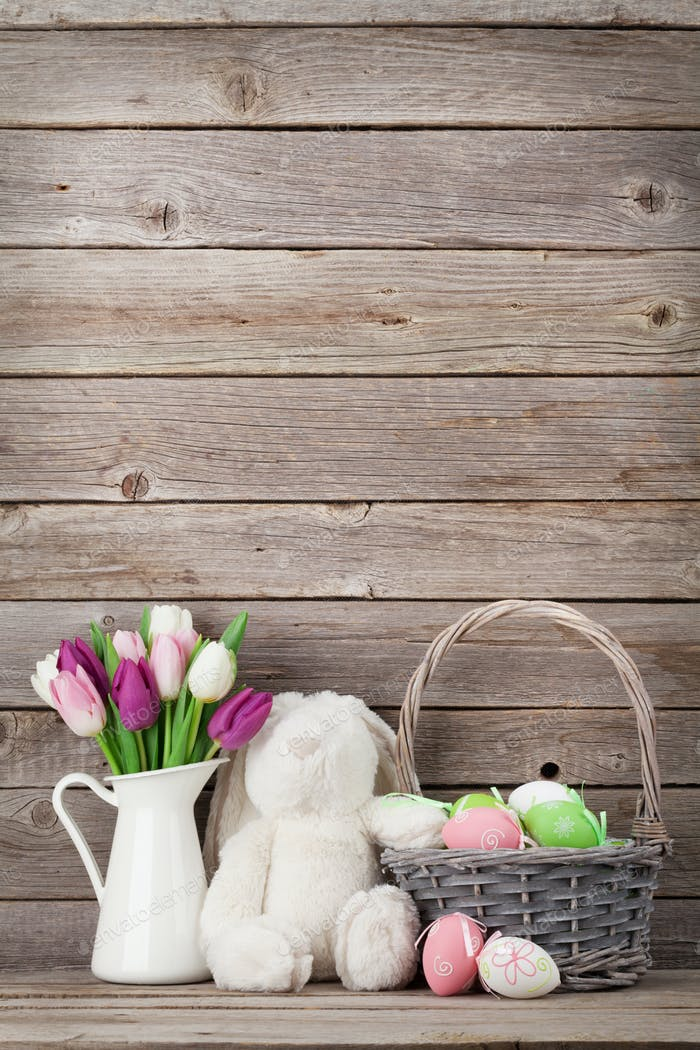 Easter eggs in basket and tulips