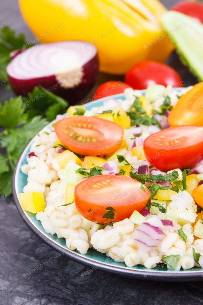 Fresh salad with bulgur groats and vegetables as best food for dieting and slimming