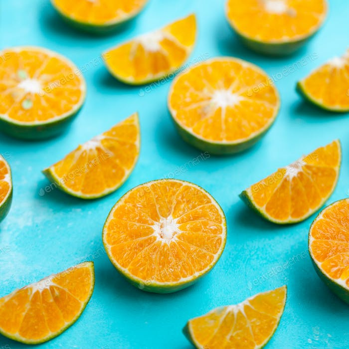 Oranges on Blue Background. Flat Lay Composition. Close up.