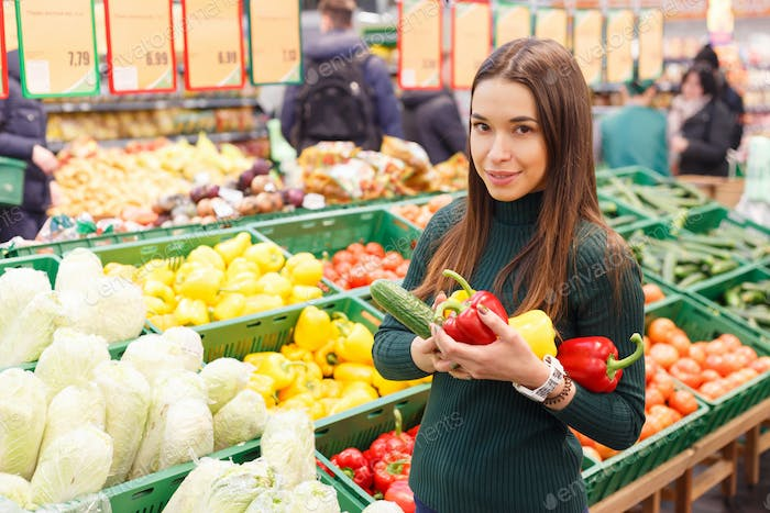 Thumbnail for Young woman on the market with vegetables