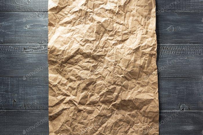 wrinkled paper at wood