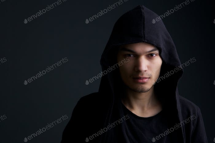 Male fashion model on black background