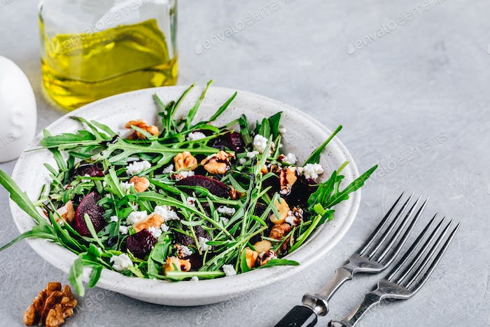 Arugula beet salad with goat or feta cheese and walnuts