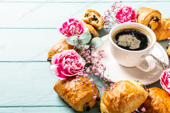 Mini fresh croissants bun and coffee