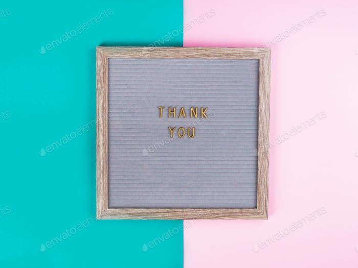 Thank you written on board on colorful background