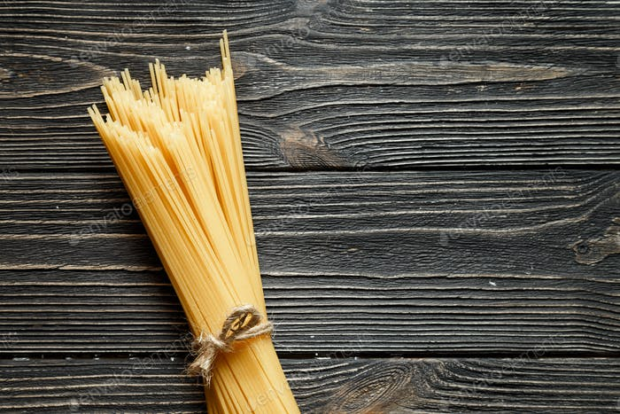 Banch of spaghetti on dark wooden table