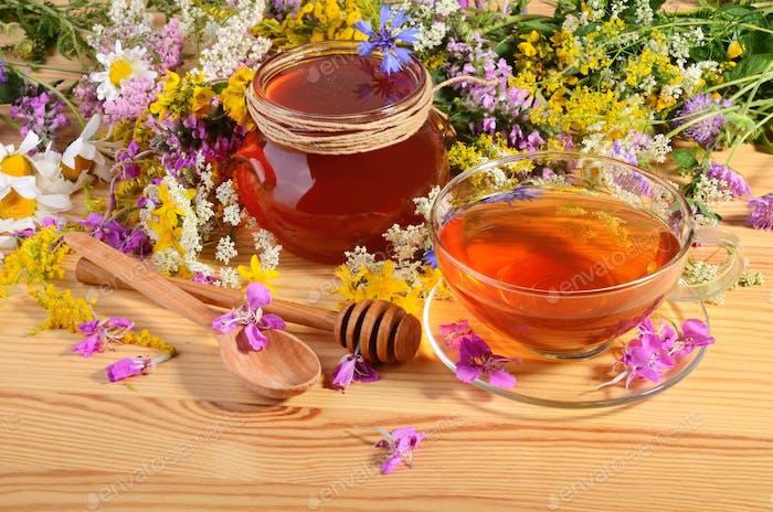 Glass pot of honey with tea