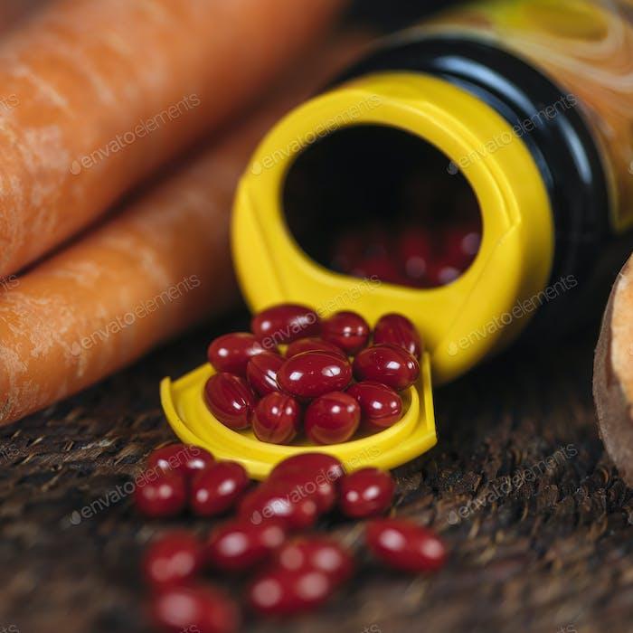 Beta Carotene Supplement Pills and Vegetables