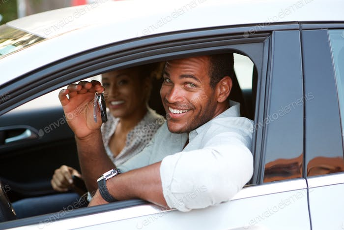 Close up African American couple sitting in car smiling
