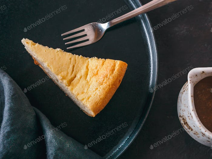 Classic Cheesecake on dark background. Top view