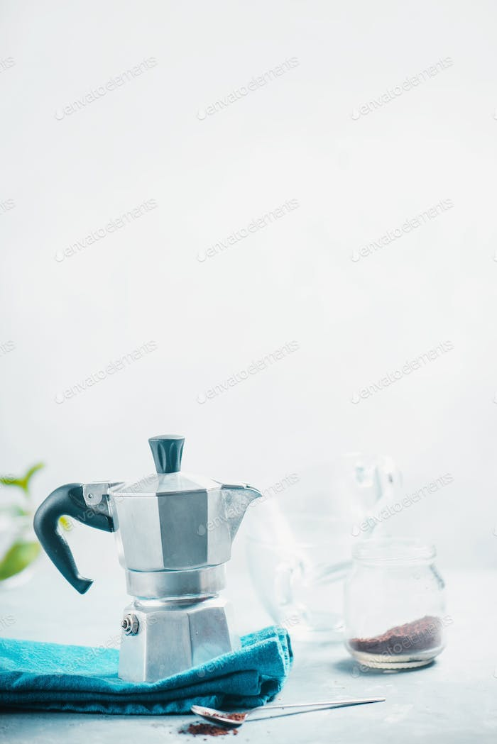 Brewing coffee in Moka pot concept. Morning routine photography with copy space.