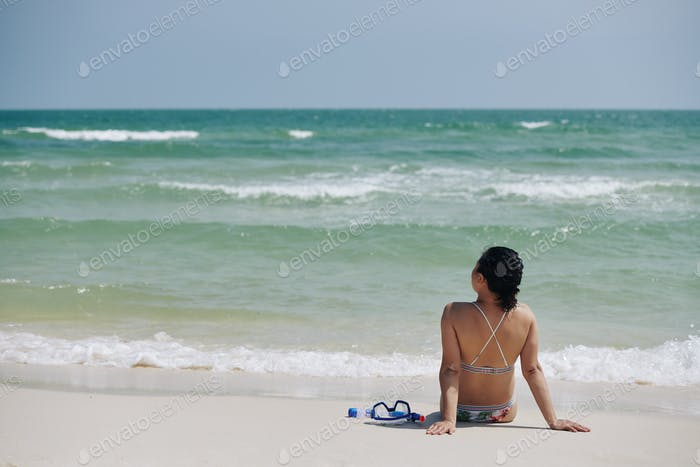 Woman looking at sea waves