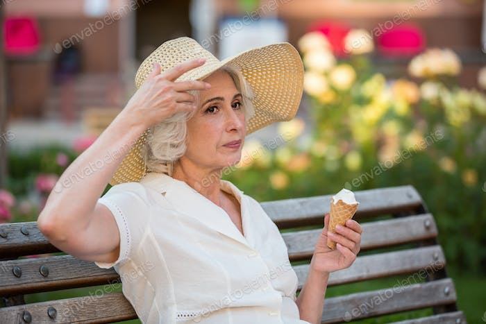 Mature woman with ice cream