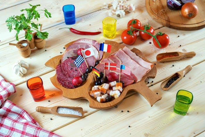 Various Meat Delicacies and Spices on Wooden Table