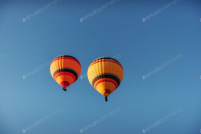 group of colorful hot air balloons against a blue sky