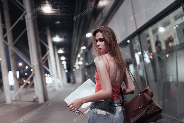 Am i lost. Beautiful girl walking near the building and turn around. Photo in motion